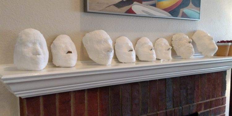 Our AWG Masks drying on Mantel-Small